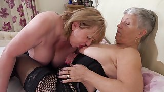 Chubby grannies wearing stockings making love on the bed