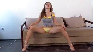 Teen girl posing naked on a love-seat